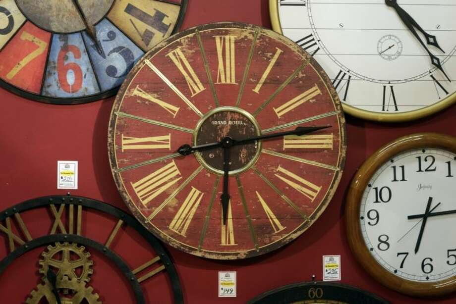Clocks hang on a wall in Hands of Time, a clock store and repair shop in Savage, Md., Friday. It's the weekend to spring ahead for daylight saving time. Not every place makes the switch. The exceptions are Hawaii, most of Arizona, Puerto Rico, the Virgin Islands, American Samoa, Guam and the Northern Marianas. Photo: Patrick Semansky