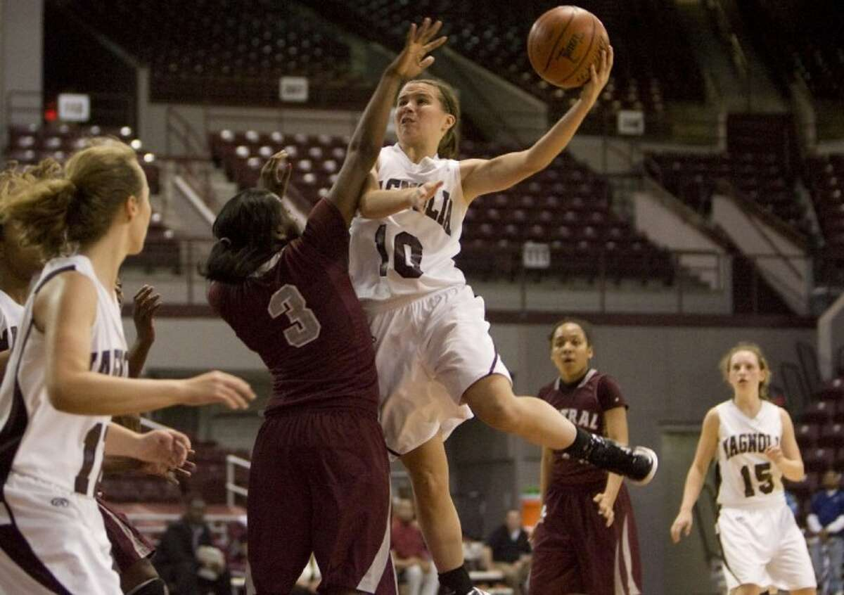 Magnolia's Allison Abendschein drives to the basket during a Region III-4A area playoff game at the Campbell Center in Houston. Abendschein was named the All-District 17-4A Most Valuable Player.