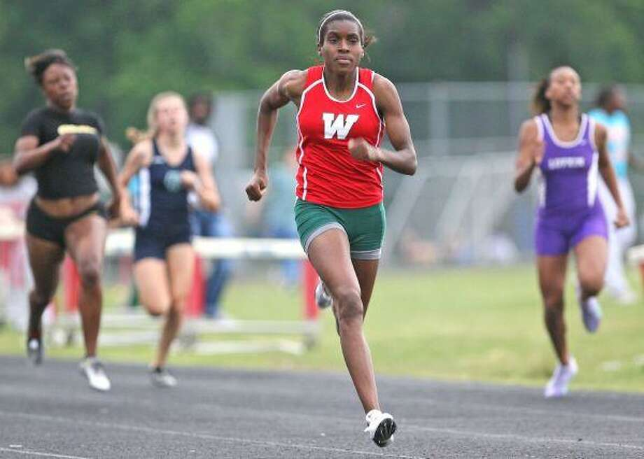 The Woodlands' Sunday Foster bolts towards the finish line during the 200-meter dash at Thursday's District 14-5A track and field meet hosted by Oak Ridge High School. Foster finished first in the event. / The Courier