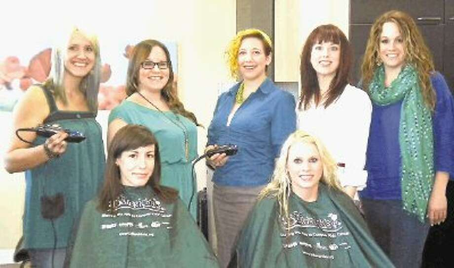 Sprout Salon stylists will volunteer to shave heads Sunday at the St. Baldrick's Foundation fundraiser at Goose's Acre. Pictured are: (left to right, back row) Jenny Bussolati-Jordan, Karen Agafitei, Andrea Clark, Amy Edward and Jaci Chaham-DeVita. Sitting are Jade Pletz and Brittney Key. Not pictured is Marisa Castaneda. / @WireImgId=2617807