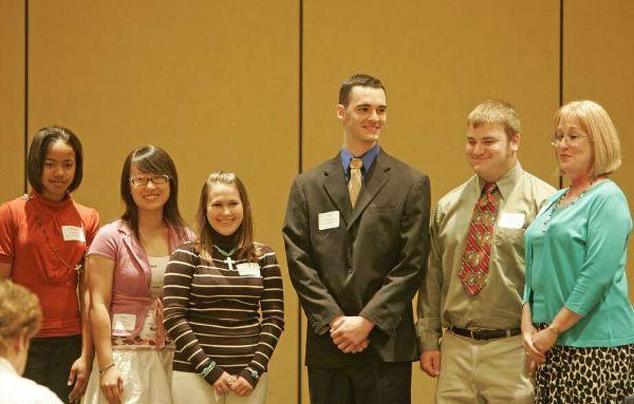 Six CISD high school seniors and 19 CISD teachers received scholarships from the Conroe Independent School District Education Foundation during the foundation's annual breakfast meeting Tuesday at The Woodlands Waterway Marriott.