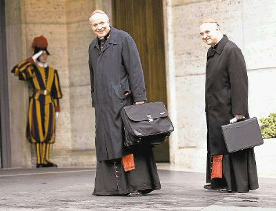 Cardinal Christoph Schoenborn, center, and Cardinal Angelo Comastri arrive for an afternoon meeting, at the Vatican. Photo: Alessandra Tarantino / AP2013