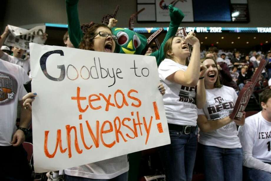 Bridget Hendricks, left, a senior from Tampa, Fla., yells as she holds her sign before an NCAA college basketball game between Texas and Texas A&M, Monday, Feb. 6, 2012, at Reed Arena in College Station. Texas A&M is leaving for the Southeastern Conference. Photo: Nick De La Torre