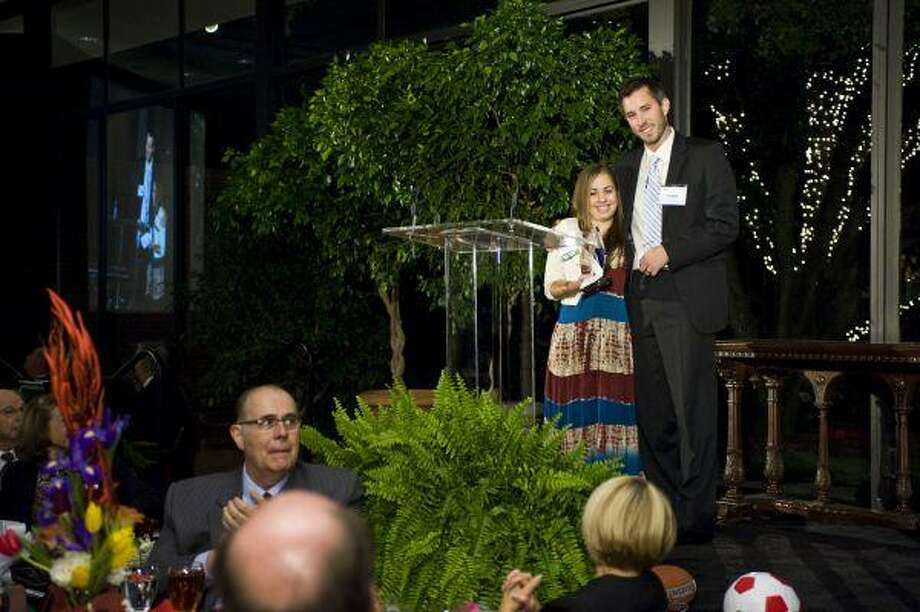 Sarah McClure, a senior at The Woodlands College Park High School, receives the Jessica Loverich Award as the Youth Volunteer of the Year for the YMCA of Greater Houston. Former South Montgomery County YMCA Teen Director Lee Elliott presented the award. / KENNON EVETT