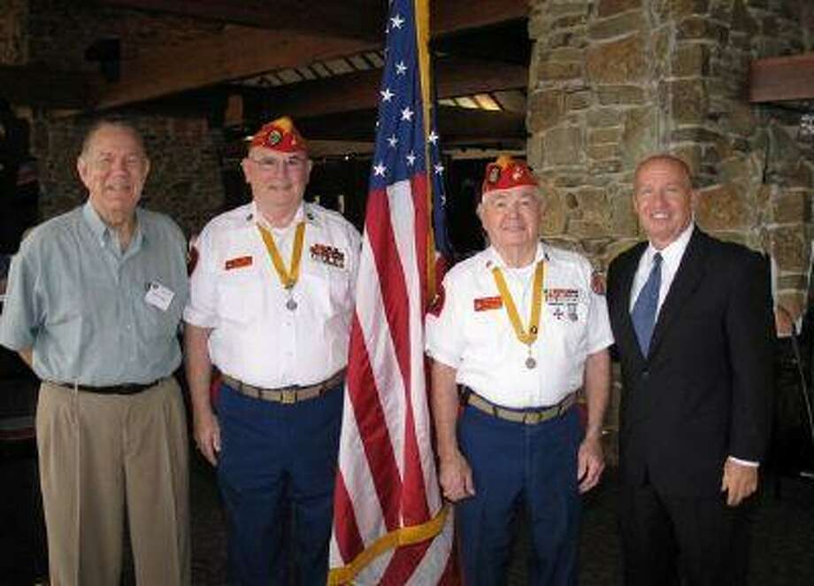 Walden Men's Association President John Conley, far left, welcomed U. S. Congressman Kevin Brady, R-The Woodlands, far right, as guest speaker at the association's monthly meeting. Brady spoke of the need for congressional action on an energy bill. Conley also welcomed Marines Bob Quinn, second from left, senior vice commandant for the Texas Marine Corps League, and Harry Bruce, second from right, state commandant. who presented the colors at the meeting.