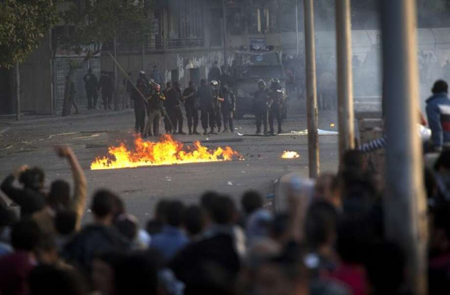 Egyptian protesters clash with riot police in downtown Cairo, Egypt, Saturday. Photo: Nasser Nasser