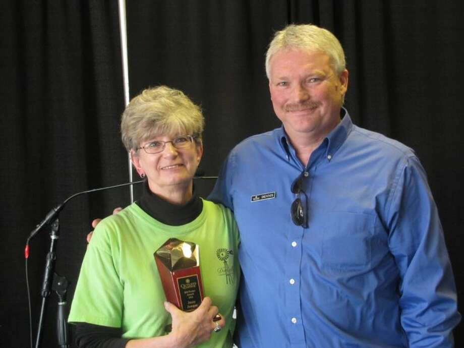 The Jazzy Junque & Other Great Stuff upscale resale shop, which benefits New Danville, was named the recipient of the 2012 Outlets at Conroe's Annual Bill Porter Award. Pictured are Linda Hein, manager of Jazzy Junque, with Dennis Brown, chief operating manager of The Outlets at Conroe.