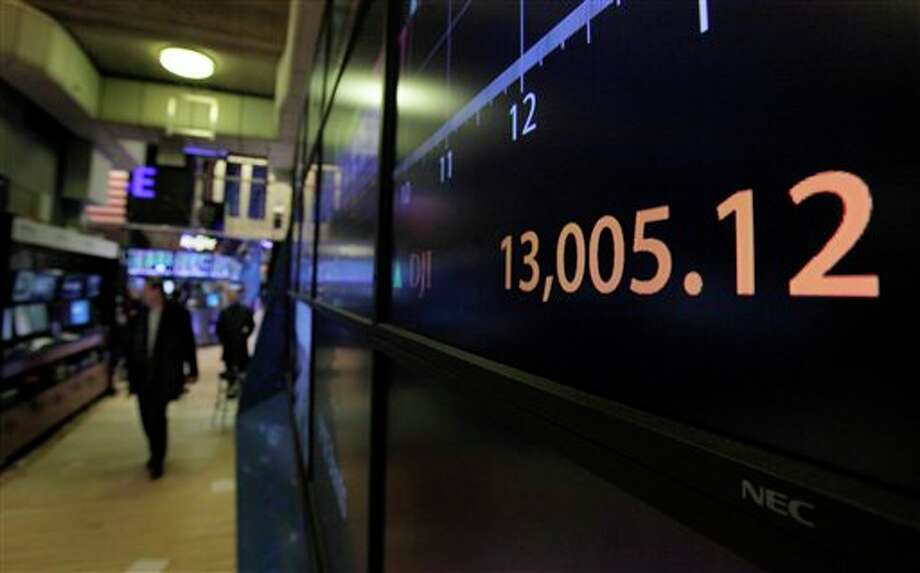 A board on the floor of the New York Stock Exchange shows the closing number for the Dow Jones Industrial average, Tuesday, Feb. 28, 2012. The Dow Jones industrial average closed above 13,000 Tuesday, the first time since May 2008, four months before the financial crisis. (AP Photo/Richard Drew) Photo: AP Photo By Richard Drew / AP