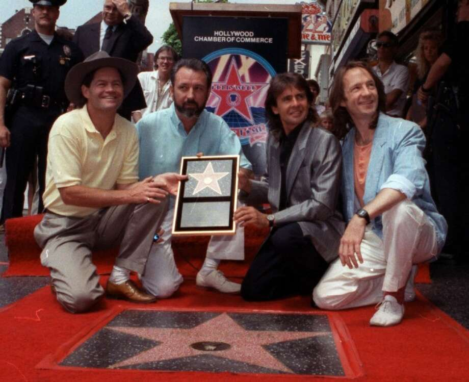 "In this July 10, 1989 file photo, The Monkees, from left: Micky Dolenz, Mike Nesmith, Davy Jones and Peter Tork get a star on the Hollywood Walk of Fame in Los Angeles. Jones died Wednesday in Florida. He was 66. Jones rose to fame in 1965 when he joined The Monkees, a British popular rock group formed for a television show. Jones sang lead vocals on songs like ""I Wanna Be Free"" and ""Daydream Believer."" Photo: Mark Terrill"
