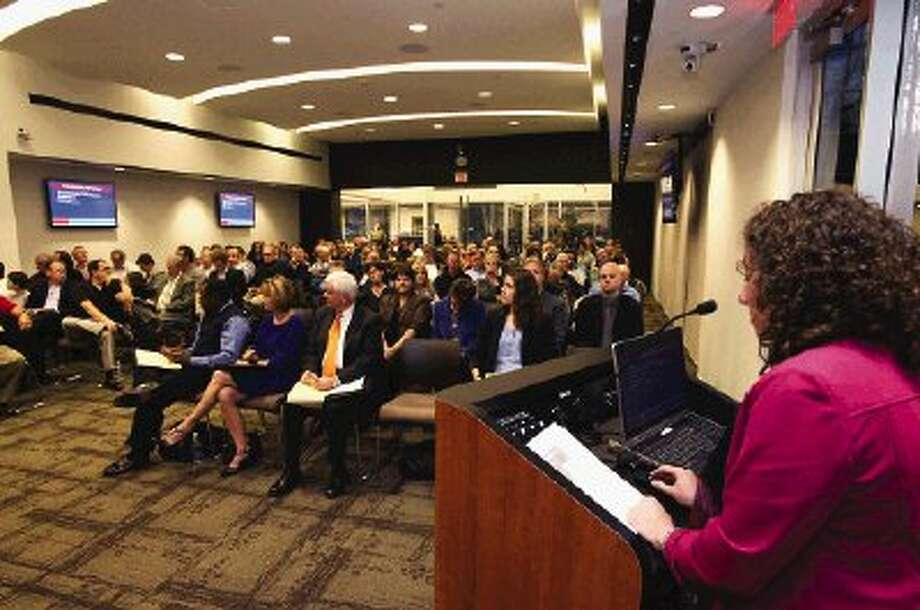Kroger consumer affairs executive Joy Partain addresses a near-capacity crowd at a public forum on a proposed fueling station Tuesday night.