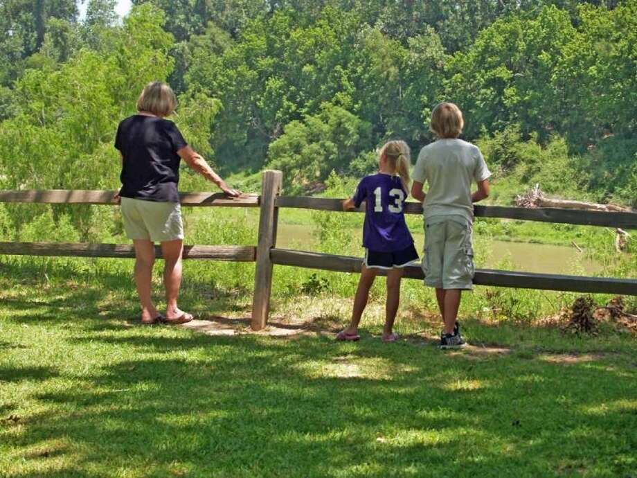 My wife and two of my grandchildren enjoy the scenery at Washington-on-the-Brazos State Park.