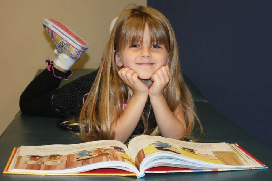 A Birnham Woods student enjoys reading her book.