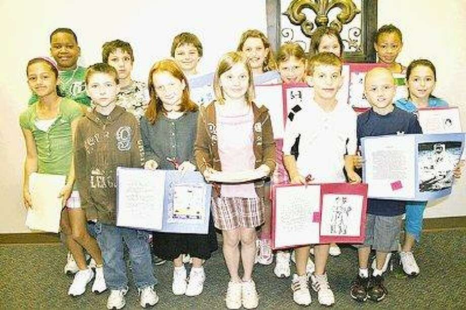 The Lake Conroe Area Republican Women recently held an essay contest where students researched the lives of American heroes and explained why they were important. Winners from Montgomery Elementary School were, back row from left, Colby McWashington, Dominick Fiorella, Zack Hochhauser, Rebecca Massey, Madison Hejl, Kaila Souheaver, Torrye Poldo; front row from left, Mackenzi Masich, Marc Crosby, Sheridan Fayle, Paige Novakowski, Luke Coleman, Travis Politakis and Kaitlyn Crow.