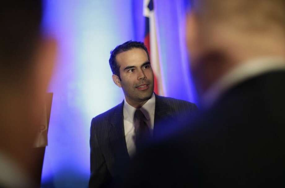In this Feb. 26, 2013 file photo, George P. Bush, left, talks to businessmen prior to making the opening statements at the Texas Business Leadership Council in Austin, Texas. Ending months of speculation about what post the grandson of one former U.S. president and nephew of another planned to seek, spokesman Trey Newton told The Associated Press that Bush filed the official paperwork Tuesday to run for land commissioner, a popular stepping stone to higher office. Photo: Eric Gay