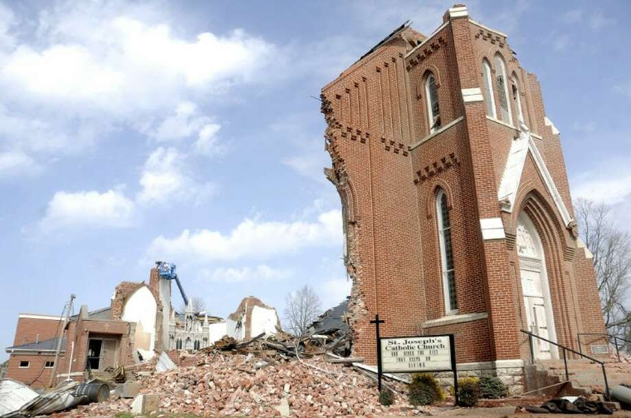 St. Joseph's Catholic Church is left in ruins after a severe storm hit in the early morning hours on Wednesday in Ridgway, Ill. Photo: Paul Newton