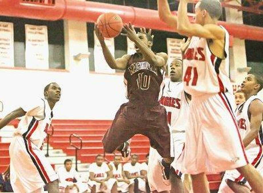 Magnolia's Jarard Hood attempts to score a basket against Atascocita on Dec. 10 at Splendora High School. / The Courier
