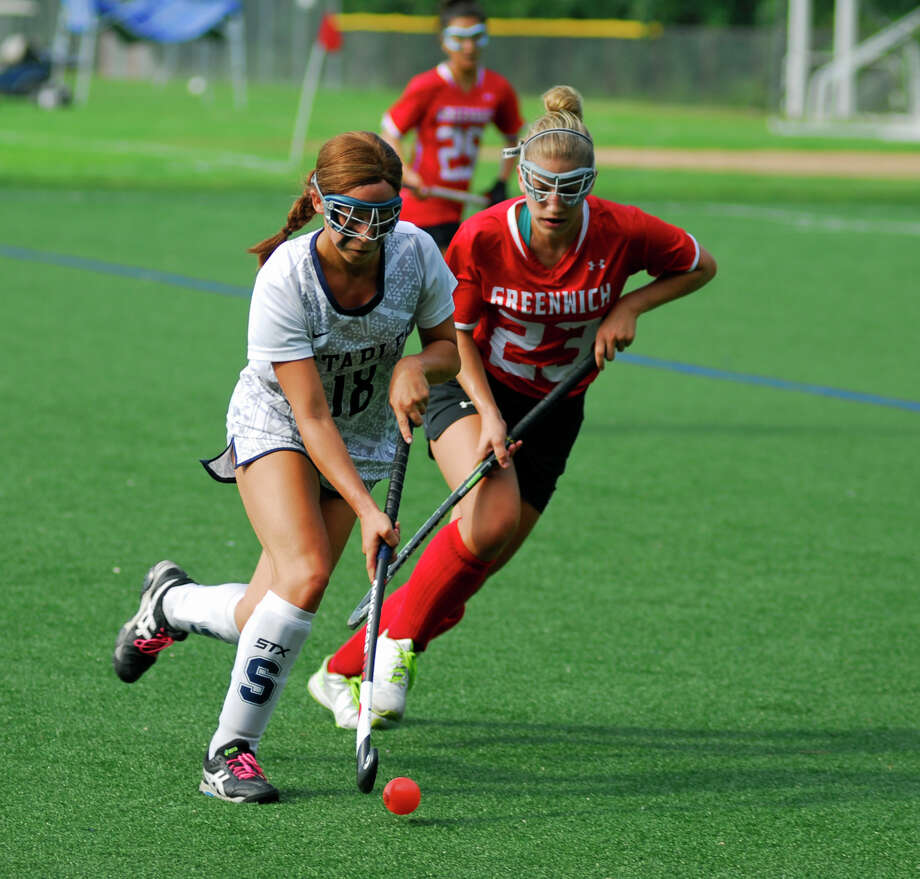 Staples' Alexis Bernard and Greenwich's Sammy Gould battle for possession during a field hockey game on Saturday, September10th, 2016. Photo: Ryan Lacey/Hearst Connecticut Media / Westport News Contributed