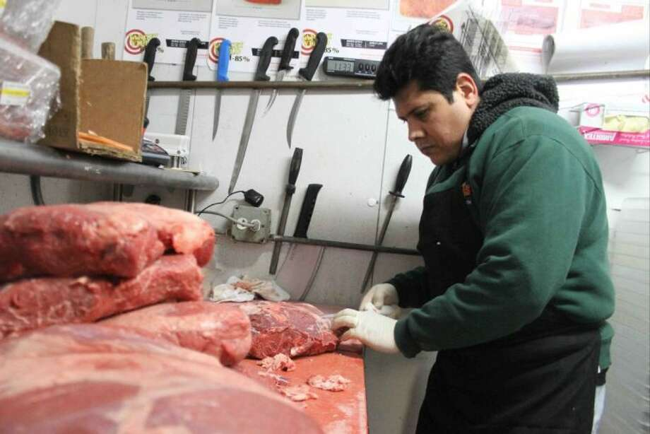 Butcher Jesus Jaimes trims sirloin at Texas Roadhouse in Conroe on Wednesday. Jaimes will compete in the Texas Roadhouse National Meat Cutting Challenge in San Antonio on March 25 for the chance to compete for the grand prize of $20,000 in Maui, Hawaii. Photo: Staff Photo By Jason Fochtman