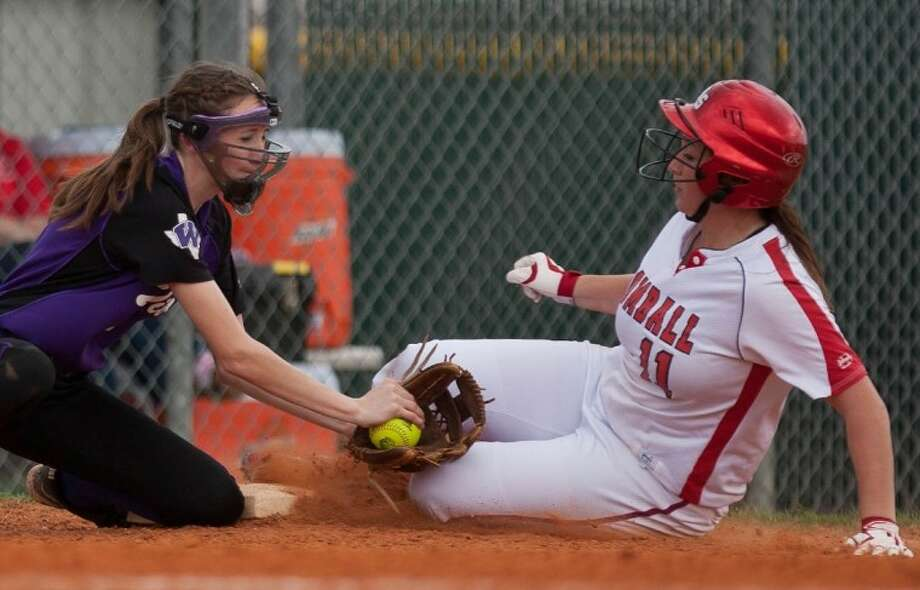 Willis' Rachel McCrary applies the tag to Tomball's Kelsey Vincent during Thursday's Cy-Fair tournament game at Jersey Village High School in Houston.