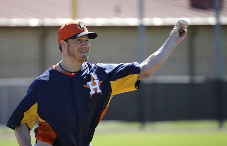 Houston Astros pitcher Erik Bedard throws during a spring training workout Feb. 18 in Kissimmee, Fla. Photo: David J. Phillip