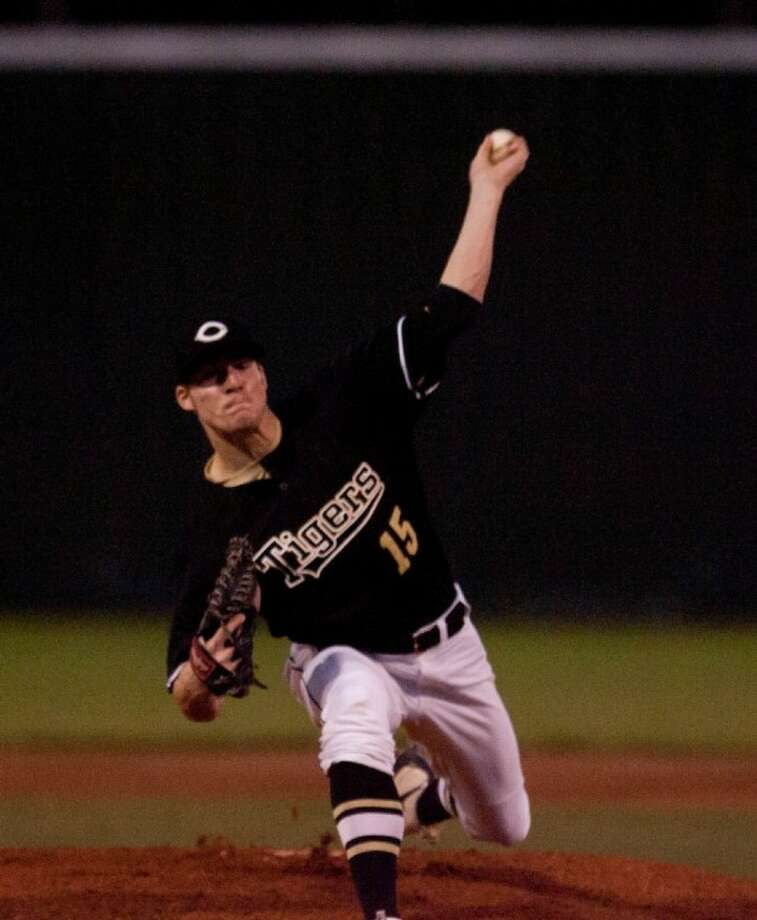 Conroe's Cody Myrick delivers a pitch against Alvin during Thursday's annual Ferrell Classic tournament at Conroe High School. Photo: Staff Photo By Eric S. Swist