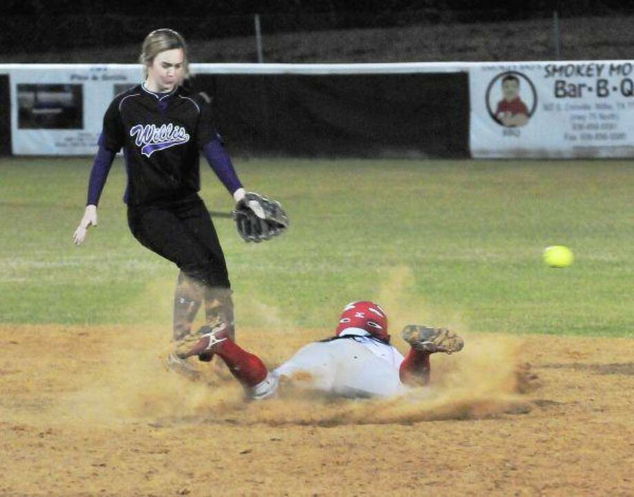 Oak Ridge's Kris Davila steals second base as Willis shortstop Racheal McCrary covers the bag Tuesday night.