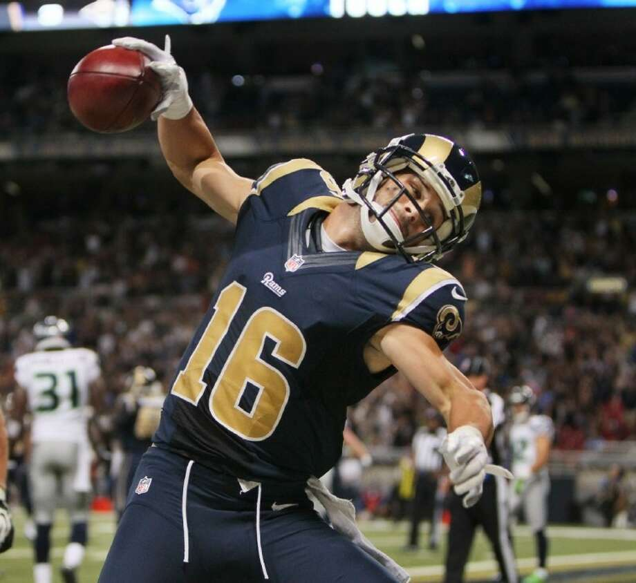 Rams receiver Danny Amendola, who played high school ball at The Woodlands, spikes the ball after scoring on a pass on a fake field-goal play. Photo: Chris Lee