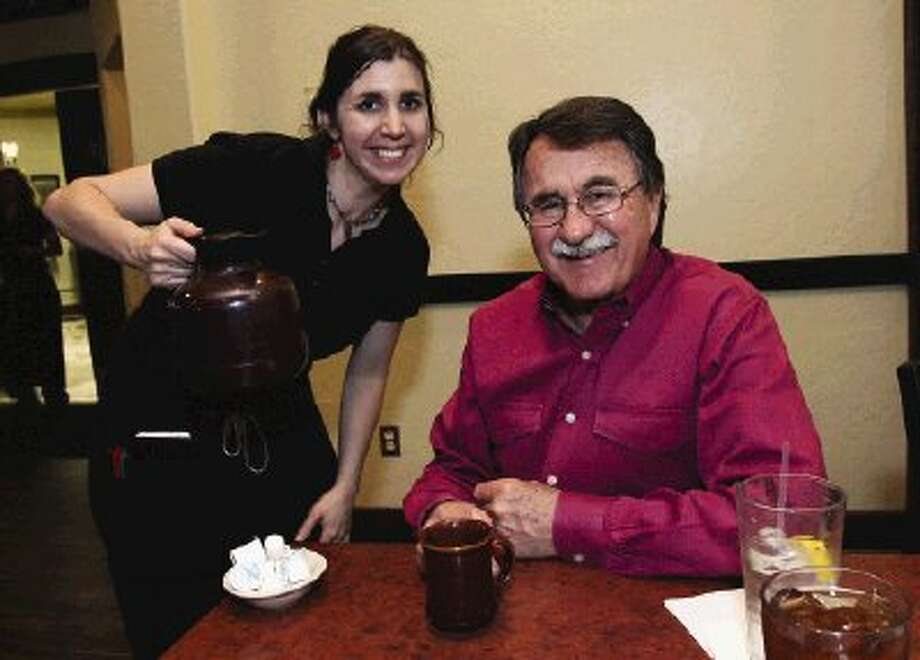Conroe Mayor Webb Melder gets a cup of fresh brewed coffee at the Toasted Yolk after lunch.