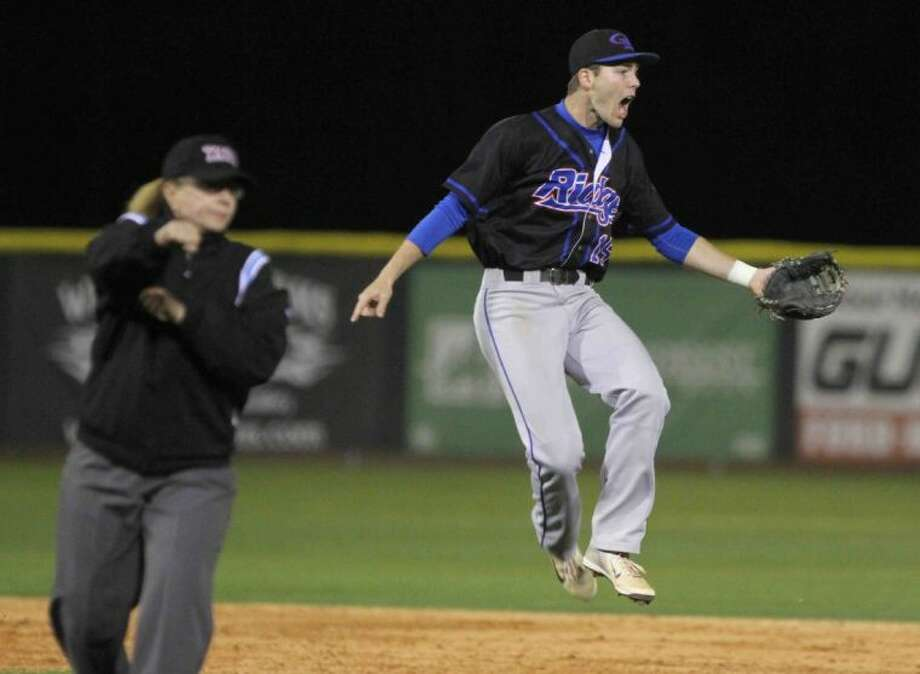 Oak Ridge shortstop Branden Navarro celebrates after getting an out at second base during a District 14-5A game at College Park on Thursday. To view or purchase this photo and others like it, visit HCNpics.com. Photo: Staff Photo By Jason Fochtman