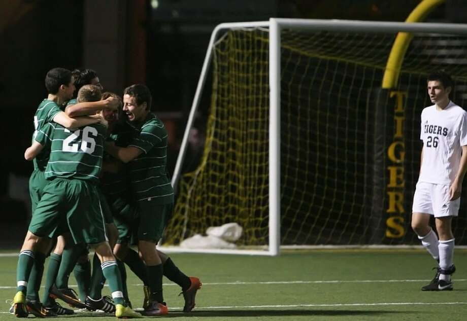 The Woodlands' Julian Fajardo celebrates his second-half goal with teammates during Tuesday night's game against Conroe.