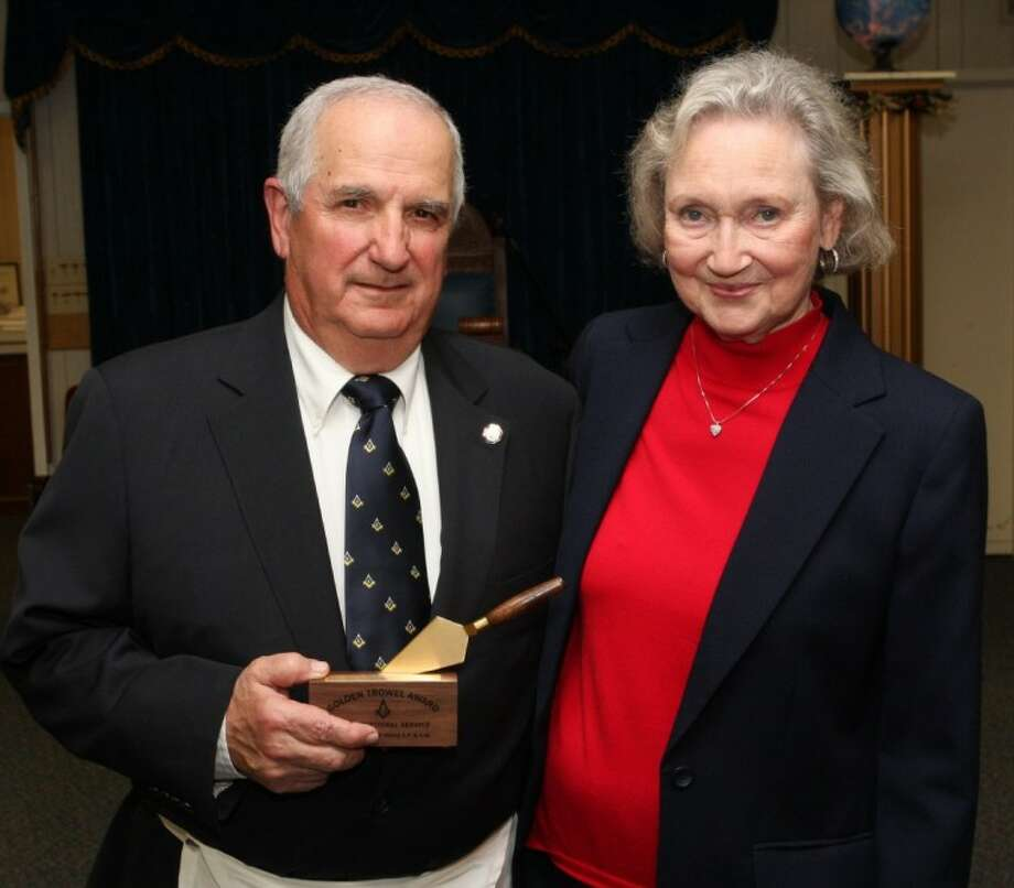 A.E. Chiosini with his wife, Sally, after being presented the 2012 Golden Trowel Award. The Golden Trowel Award is the San Jacinto Masonic Lodge No. 106 in Willis' formal recognition of a brother for his devoted service to his Masonic principals in general.