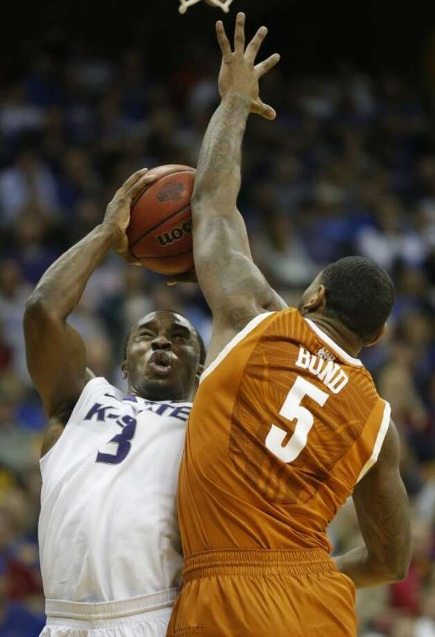 Kansas State guard Martavious Irving (3) shoots over Texas forward Jaylen Bond in the Big 12 Tournament. Texas lost 66-49. Photo: Orlin Wagner