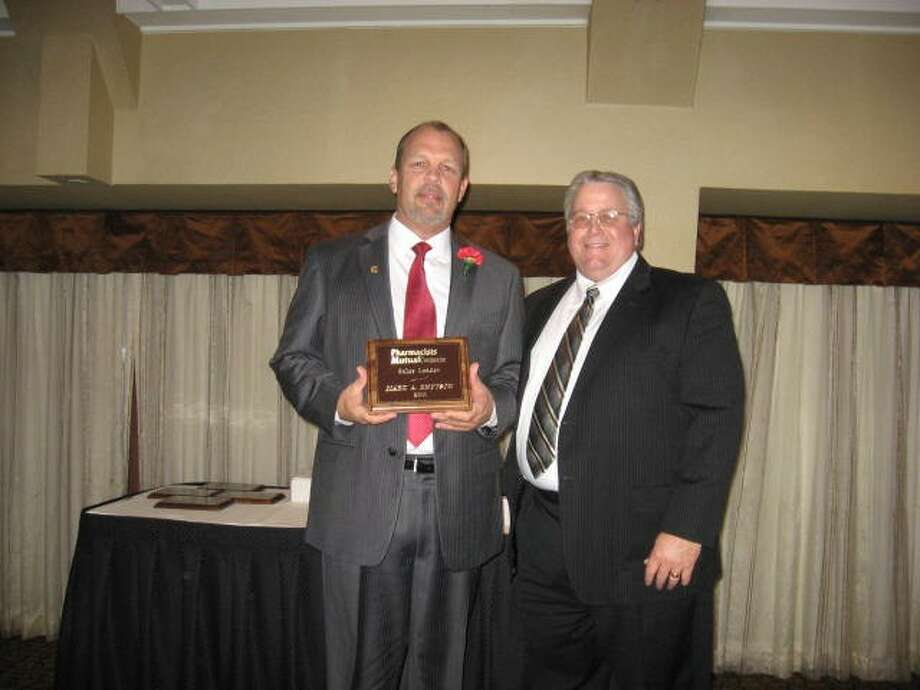 Mark Knutson, of Montgomery, was named Pharmacists Mutual Insurance Company 2011 Sales Leader. Bobby Albrecht, west sales team leader, presented the award to Knutson at the 2012 Annual Sales and Marketing Meeting in Kansas City.