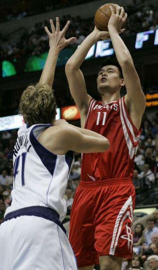 Houston Rockets center Yao Ming shoots over Dallas Mavericks forward Dirk Nowitzki earlier this week. A healty Yao will go a long way in helping the Rockets get past the first round of the playoffs. / AP