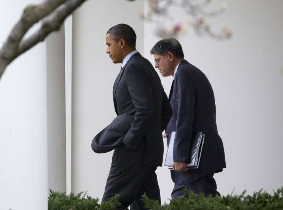 President Barack Obama and White House Chief of Staff Jack Lew walk out of the Oval Office of the White House in Washington Friday. Obama traveled to the Walter Reed National Military Medical Center in Bethesda, Md., to visit with wounded service members. Photo: Pablo Martinez Monsivais