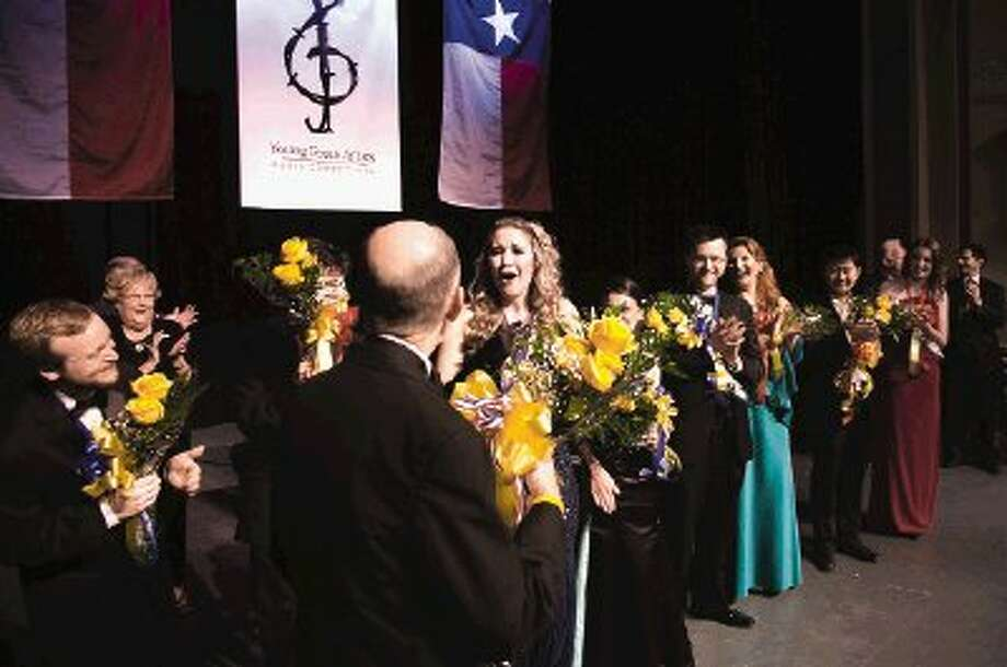 "Soprano Ashly Neumann reacts with surprise after being named ""crowd favorite"" in the 29th annual Young Texas Artists music competition held Saturday at the Crighton Theatre in Conroe."