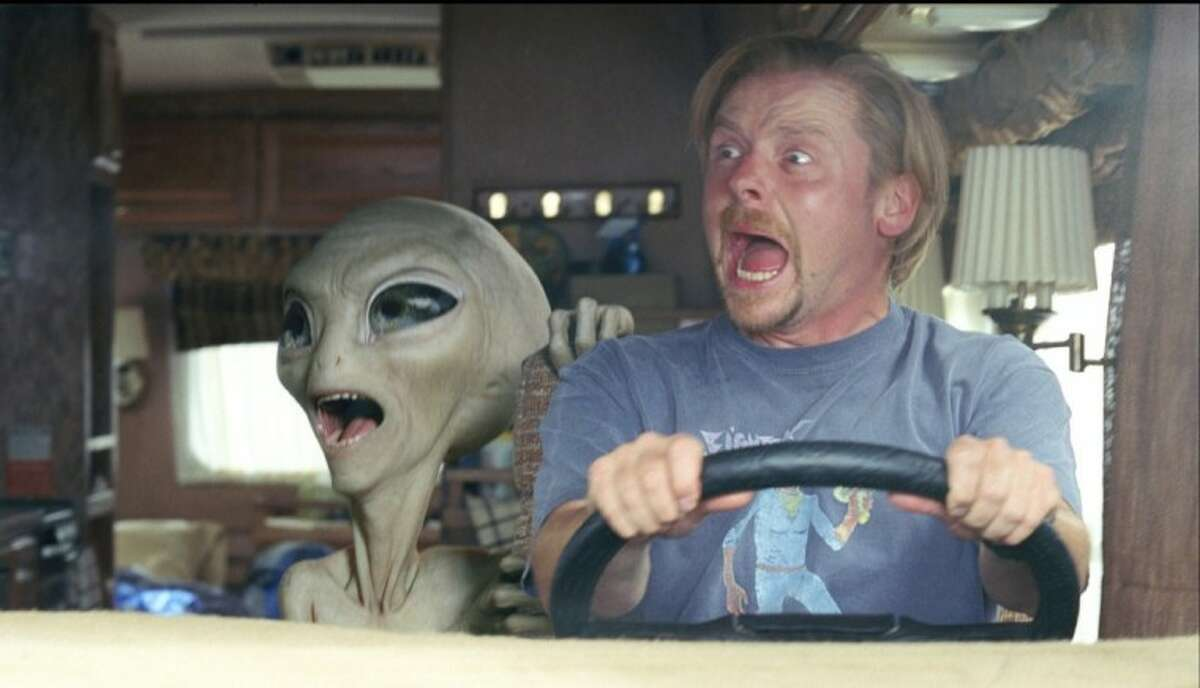 """In this film publicity image released by Universal Pictures, Paul the alien, voiced by Seth Rogen, left, and Simon Pegg are shown in a scene from the film, """"Paul."""""""