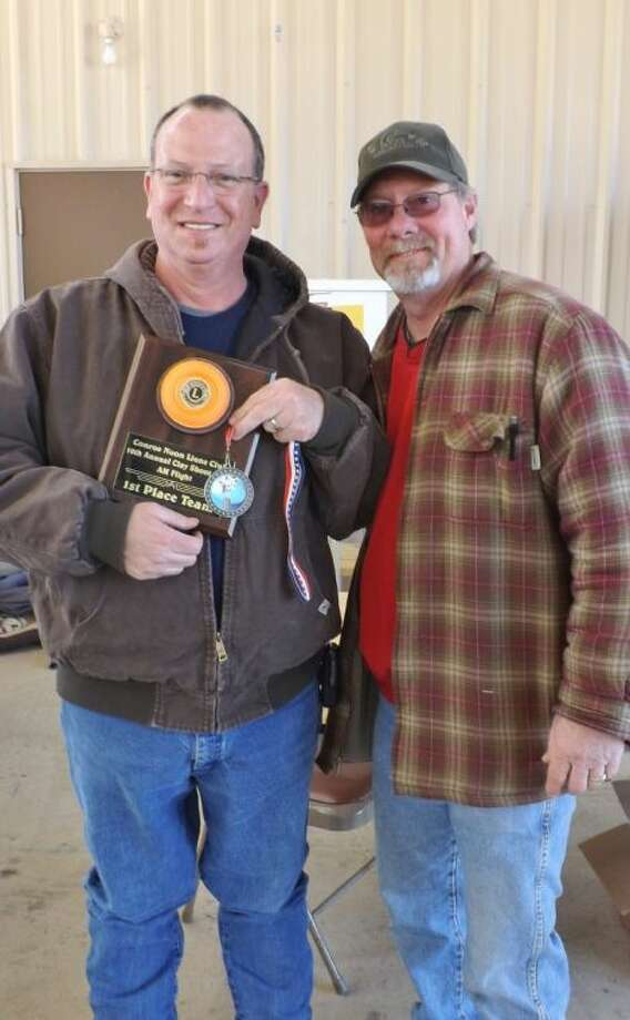 Kurt Sherrod, left, not only took 1st place with his team but he also was High Point Individual during the AM flight at the 10th Annual Clay Shoot hosted by the Conroe Noon Lions Club; also pictured, Shoot Chairman Tim Cantrell.