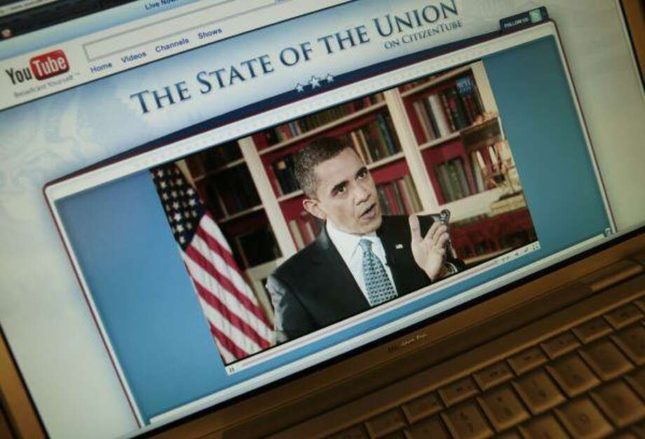 President Barack Obama is seen on the White House YouTube channel Monday on a computer screen at the White House in Washington, answering video and text questions submitted by YouTube. / AP2010