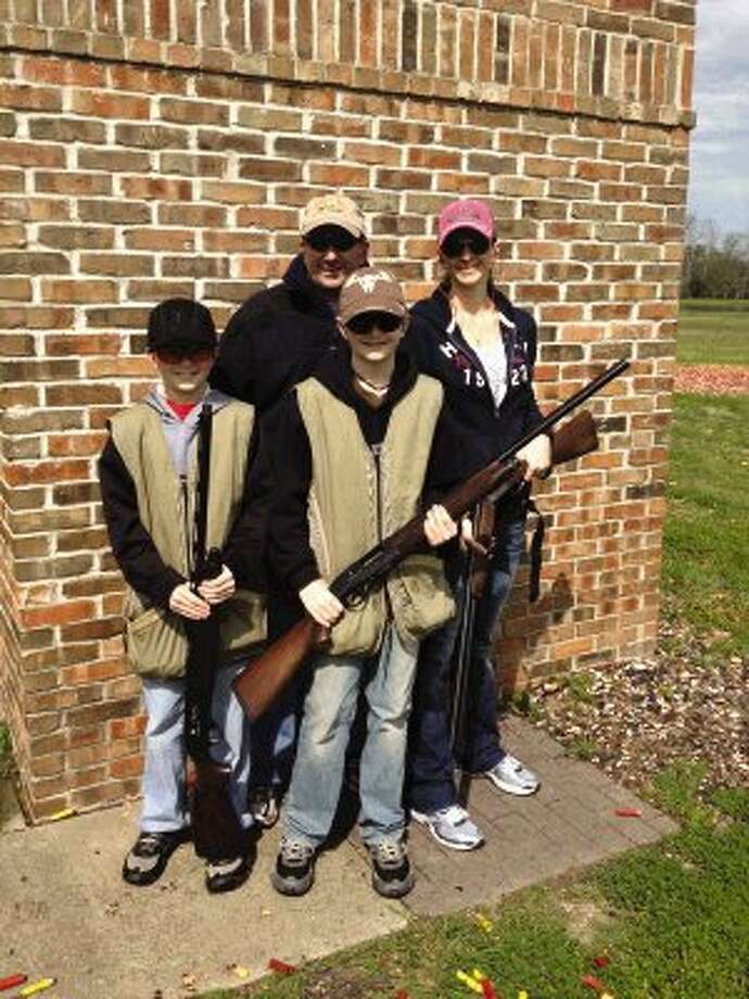 Lion Philip Dupuis is pictured with his wife Vickie and sons Mason and Logan, who each won youth awards at the Conroe Noon Lions Club Skeet Shoot Saturday.