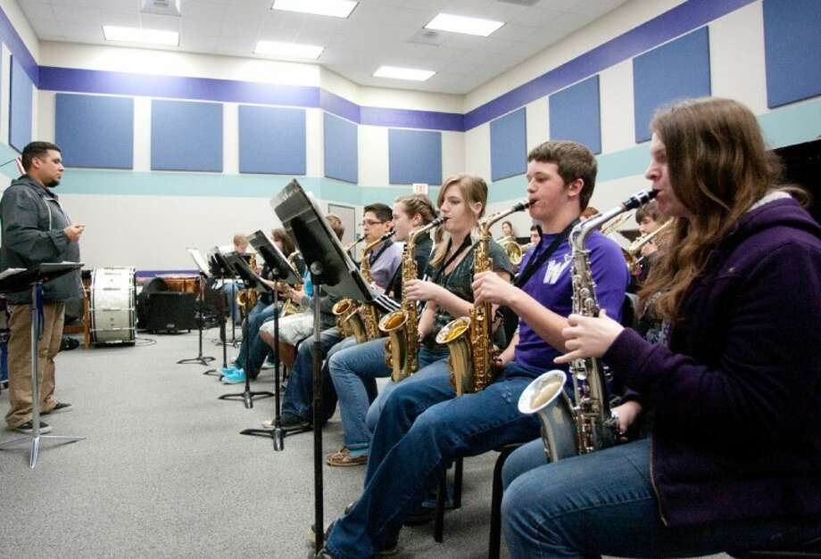 Band Director Matt Martinez, left, leads members of the Willis High School Jazz Band during a practice session at the school. Photo: Staff Photo By Eric S. Swist