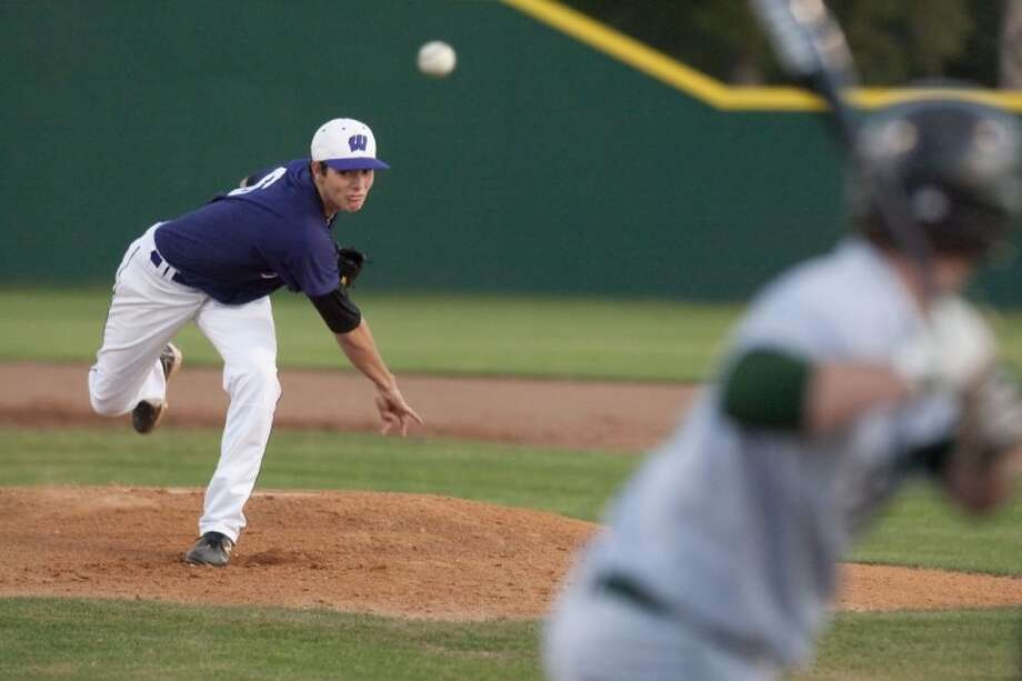 Willis' Holden Helmink pitches to Livingston in a non-district game Monday in Willis. Photo: Karl Anderson