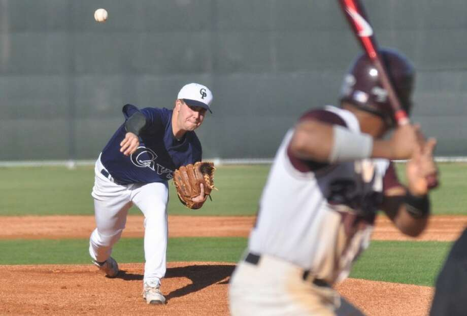 College Park's Jeff Crocker fires a pitch against Cy-Fair at the Ferrell Classic at the Diamonds at College Park on Saturday. Photo: Keith MacPherson