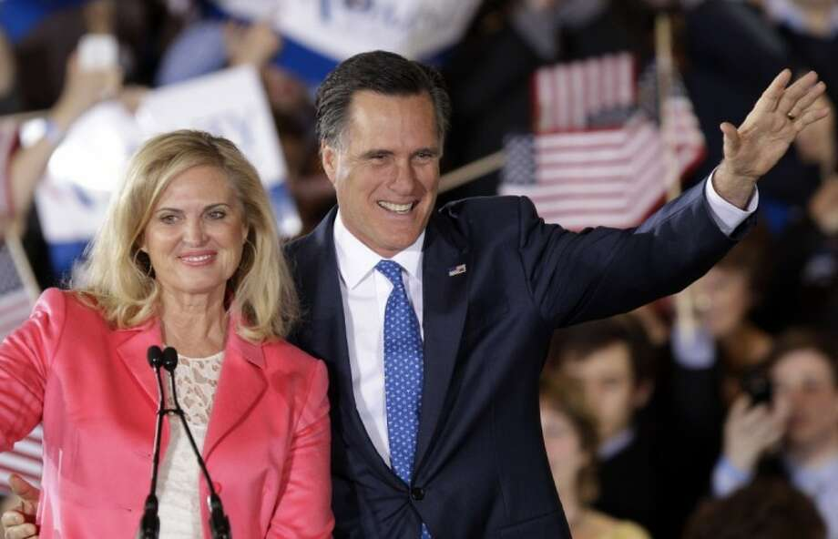 Republican presidential candidate and former Massachusetts Gov. Mitt Romney and his wife Ann wave to supporters at his Super Tuesday campaign rally in Boston. Romney had the upper hand in Super Tuesday voting across 10 states. Photo: Stephan Savoia