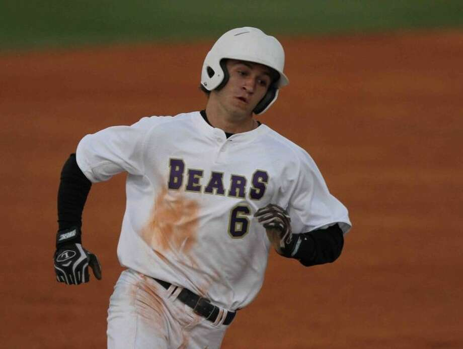 Montgomery's Gunner Vaught rounds third base during Friday's game against Brenham. To view or purchase this photo and others like it, visit HCNpics.com. Photo: Staff Photo By Jason Fochtman