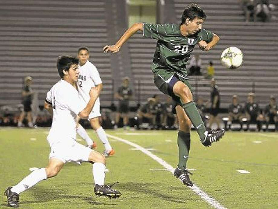 The Woodlands' Julian Fajardo attempts to maintain control of the ball during a District 14-5A game against Conroe. / The Courier