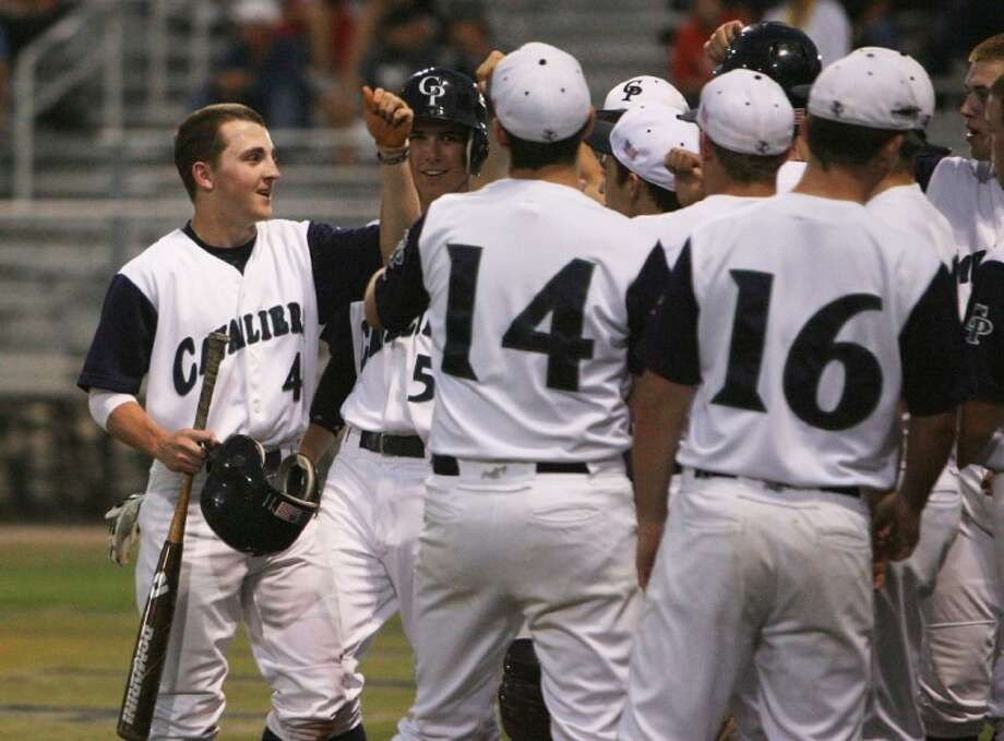 College Park's Alex Young celebrates a run with teammates during Friday night's district game against Conroe.