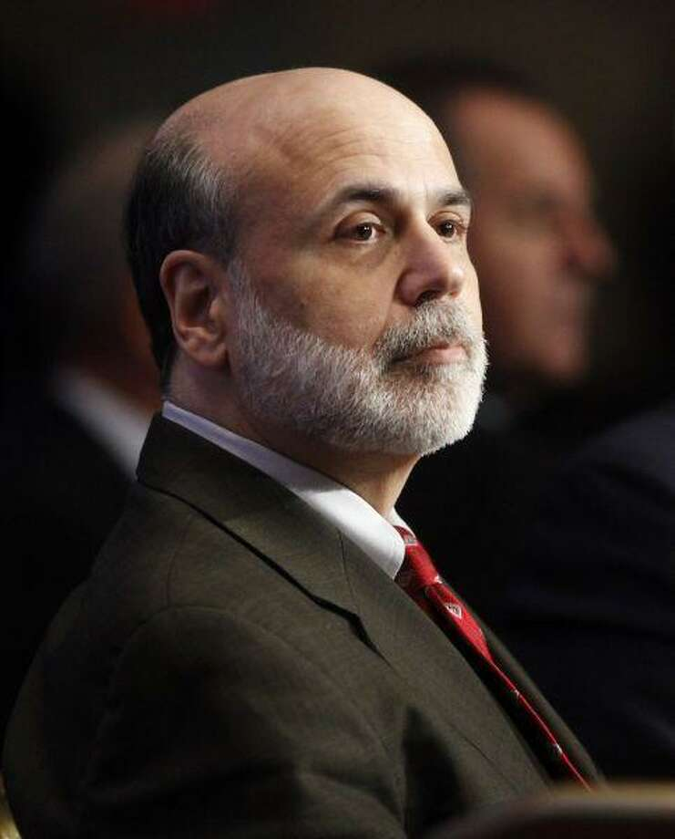 In a Dec. 7, 2009 file photo Federal Reserve Chairman Ben Bernanke waits to speak during a discussion hosted by The Economic Club of Washington, in Washington. The Senate has confirmed Bernanke for a second term as chairman of the Federal Reserve. / AP2009