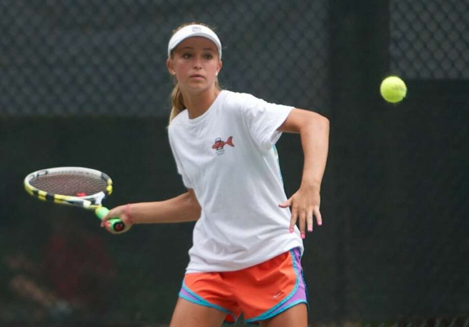Anna Gerletti plays a forehand during Saturday's girls 16 doubles quarterfinals of the Woodlands Junior Clay Court Championships at The Woodlands Country Club.