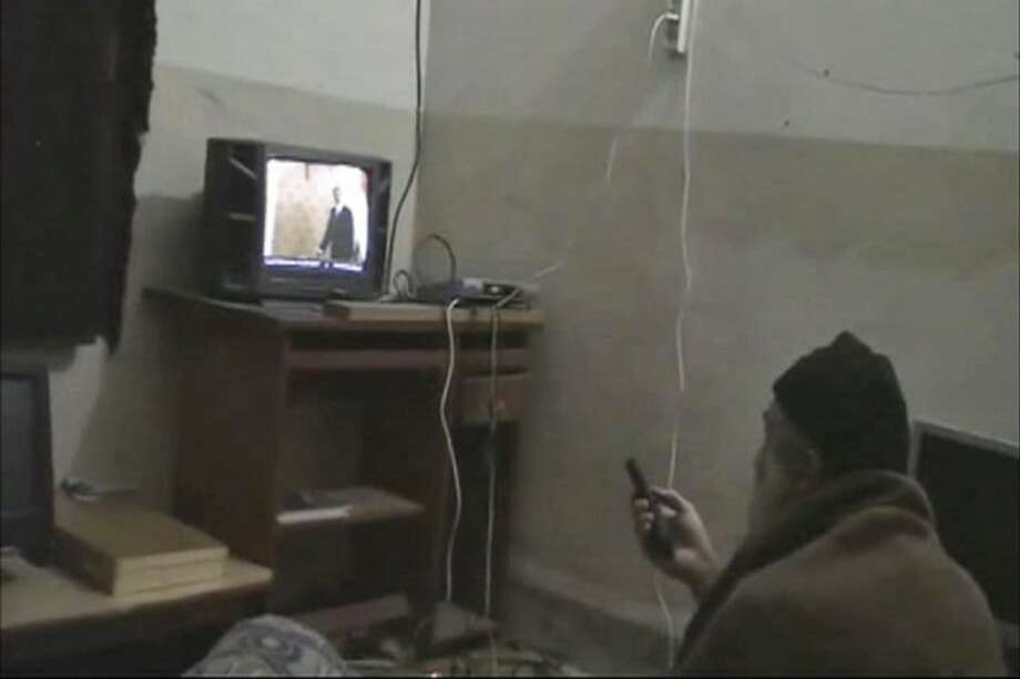 This undated image from video seized from the walled compound of al-Qaida leader Osama bin Laden in Abbottabad, Pakistan and released by the U.S. Department of Defense shows a man identified by the U.S. government as Osama Bin Laden in front of a television. Photo: Anonymous